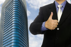 Business Man Show Thumb Up. With office building background Stock Photography