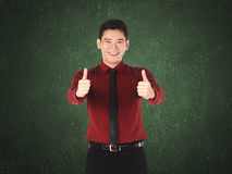 Business man show two thumbs up Royalty Free Stock Photo
