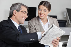 Business man showing assistent Stock Photo
