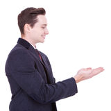 Business man showing blank area Stock Image