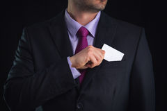 Business man showing a blank business card isolated, close up Royalty Free Stock Photography