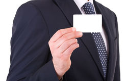Businessman showing blank card. Stock Photo