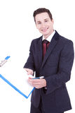 Business man showing blank clipboard. Happy smiling young business man showing blank clipboard, isolated on white background Royalty Free Stock Images