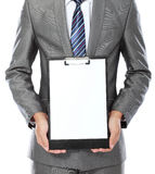 Business man showing blank clipboard Royalty Free Stock Photography