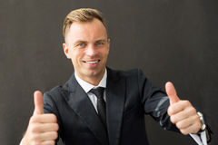 Business man showing both thumbs up Stock Images