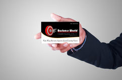 Business man showing business card Stock Image