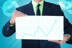 Business man showing business graph Royalty Free Stock Images
