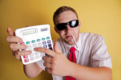 Business man showing calculator Stock Images