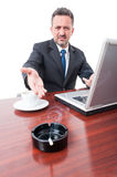 Business man showing cigarette on ashtray at office Stock Photography