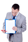 Business man showing clipboard Royalty Free Stock Photos