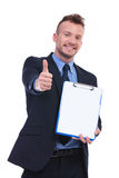 Business man showing clipboard and thumbs up Stock Images