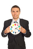 Business man showing clock Stock Photography