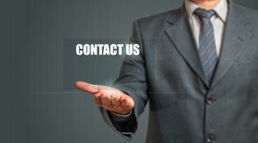 Business Man Showing Contact Us Sign Royalty Free Stock Image