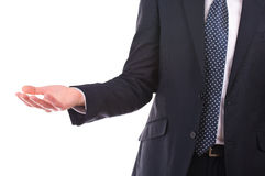 Businessman showing empty hand. Stock Photo