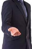 Businessman showing empty hand. Stock Image