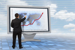 Business man showing financial growth. With an earth-map background on a 3d rendered Lcd monitor Royalty Free Stock Photo