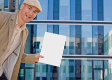 Business man showing folder. Business man in smart casual with a white file in his hand (space Royalty Free Stock Photos