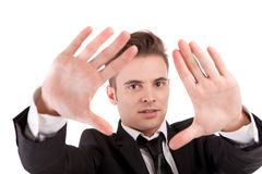 Business man showing framing hand gesture Stock Images