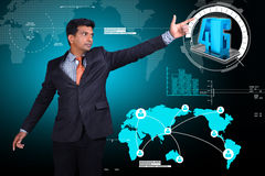 Business man showing 4G technology. In attractive background Royalty Free Stock Photo