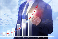 Business Man showing growth Stock Images