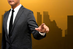 Business man showing hand and finger with city light in backgrou. Nds Royalty Free Stock Photos