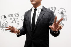 Business man showing hand and finger with hand writing business. Notes Royalty Free Stock Photography