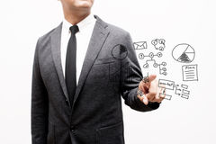 Business man showing hand and finger with hand writing business. Notes Royalty Free Stock Photo