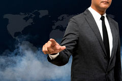 Business man showing hand and finger with smoke in background Royalty Free Stock Images