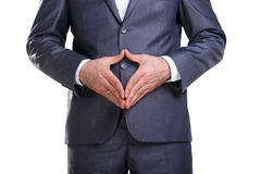 Business man showing his attitude. Business man in a suit standing and showing attitude with his hands stock photography