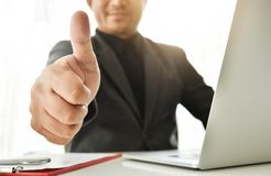Business man is showing his thumbs up. Successful of Asian Business man is showing his thumbs up Royalty Free Stock Photography