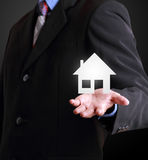 Business man showing house of property Stock Photo