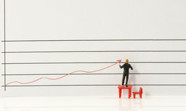 Business man showing increase graphic. Miniature man showing increase and grow of marketing by red graphic line Royalty Free Stock Image