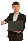 Business man showing laptop screen Stock Images