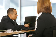 Business Man Showing Laptop To His Partner Royalty Free Stock Images