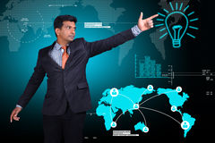 Business man showing the light bulb Royalty Free Stock Images