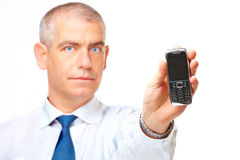 Business man showing a mobile phone Royalty Free Stock Photography