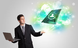 Business man showing modern tablet technology concept Royalty Free Stock Images
