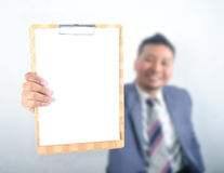 Business man showing note pad Royalty Free Stock Photo