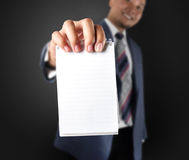 Business man showing note paper Royalty Free Stock Photo