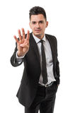 Business man showing number four Stock Photo