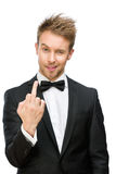 Business man showing obscene gesture. Half-length portrait of manager showing vulgar gesture, isolated on white. Concept of stress and aggression Royalty Free Stock Photo