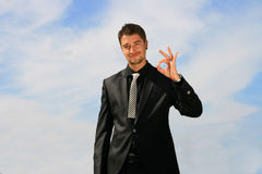 Business man showing okay sign. Elegant man showing status of his efforts Stock Photo