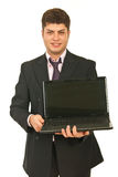 Business man showing open laptop Royalty Free Stock Images
