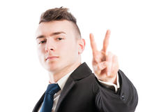 Business man showing peace or victory sign Royalty Free Stock Photo