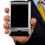 Business man showing personal digital assistant. With blank screen with clipping path for screen - add your own graph or text - on white background royalty free stock photo