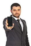 Business man showing phone display Stock Image