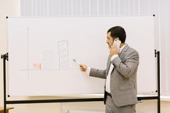 Business man showing presentation on a multimedia projector background. Technology concept. Copy space. Progressive business man showing a presentation on a new stock photo