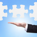 Business man showing puzzle Royalty Free Stock Photo