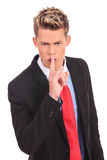 Business man showing silence gesture Royalty Free Stock Photo