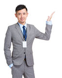 Business man showing something on open palm Royalty Free Stock Image